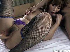 Busty oriental brunette wearing black fishnet stockings gets her hairy fish taco screwed mish and doggystyle while blowing other dude's dick. Afterwards she gets mercilessly double penetrated.
