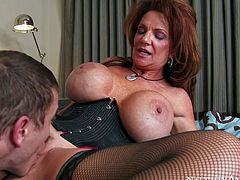 Deauxma is a gorgeous mature woman with fantastic massive tits. Slutty woman in black stockings exposes her killer melons as she gets her many times used snatch banged by younger dude.