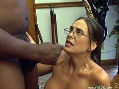The busty MILF hottie Cheyenne Hunter gets her precious lips around a big black cock and ends up getting her sexy glasses jizzed.