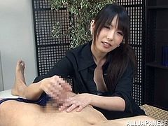 Dude relaxes on the massage table and Asian raven-haired wench decides to show how she can handle a cock. So she provides him with a handjob until buddy cums.