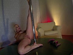 The Sexy blonde Sabina Taylor will drive you mad dancing in the pole as she moves her perfect ass and spreads her legs to show you her perfect pussy.
