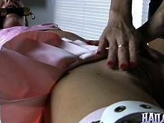 Check out this BDSM scene where the sexy Hailey Young is tied up and held up by her mistress as she's tortured and pleased by her.