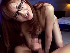 Have a good time by watching this Asian redhead, with natural boobs wearing glasses, while she gets fucked hard by a horny fellow.