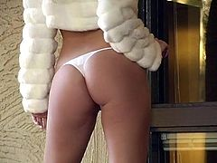 Lovely blonde solo model removes her silk dress showing her hot ass and sexy thong before shedding off her bra and caressing her sweet tits