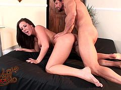 A wild brunette with big tits and a shaved pussy enjoys a fantastic missionary style fuck. Hear her scream with pleasure now!