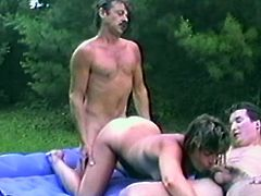 Take a look at this vintage video where this slutty brunette is fucked by two guys in a threesome outdoors that leaves her covered by semen.