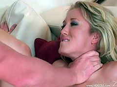Masturbate as you watch this blonde pornstar, with a nice ass wearing sexy lingerie, while she gets drilled hard over a couch and moans stridently.