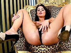 Dana Weyron with big knockers and hairless cunt kills time stroking her bush