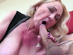 Sila whips out her big, natural tits and lets them swing as she gets on top of this guy and drives herself down on his shaft.