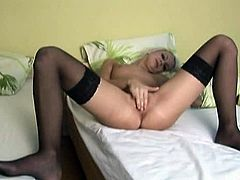We Doki brings you a hell of a free porn video where you can see how the alluring and hot blonde Natalia Halle masturbates for you while wearing black stockings.