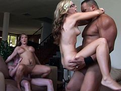 Lewd blonde milfs Tabitha James and Claire Dames are having fun with two dudes in the living room. The moms show their blowjob skills to the studs and get fucked in the cowgirl position.