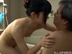 Check this Japanese brunette, with natural tits and a nice ass, while she uses her hands and mouth to satisfy an older man's wishes.