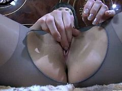 Bex chose a pair of grey pantyhose that are ripped off in the crotch area. She massaged her pussy before she inserted a dildo inside it and kept her nylons on.