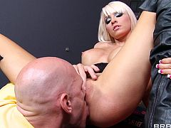 A sexy young pornstar with long blonde hair, massive tits and an awesome ass enjoys getting her shaved pussy licked and fingered.