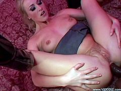 Beautiful blonde milf Sharon Wild gives a deepthroat blowjob to a black dude. After that they have doggy style anal sex and seem to enjoy it a lot.