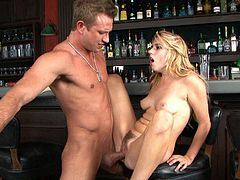 This lovely blonde knows a lot about oral sex. She sucks bartender's cock greedily to get it hard and ready. When she gets what she wants she rides his hard cock in cowgirl position.