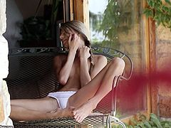 Skinny blonde Doris Ivy fingers her shaved pussy on the patio