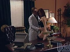 Press play on this hardcore scene where the busty redhead mom Renee La Rue is fucked by this guy in his office as she wears stockings.