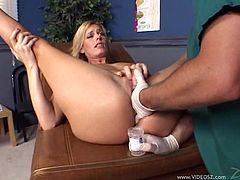 Hot blonde milf Darryl Hanah is playing dirty games with a doctor in a hospatal. The guy fingers Darryl's holes and lets the mom take a ride on his boner.