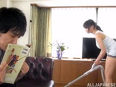 Captivating Japanese girl cleans the room. A dude seduces her and kneads her massive natural tits before making her suck his hard weiner.