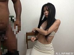 Long-haired Japanese girl is getting naughty with a bulky black guy. The dude plays with the chick's natyral tits, then drills her snatch in the missionary position.