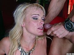 A very sexy blonde with long hair, nice small tits and a shaved pussy enjoys licking and sucking a stranger's massive cock.