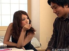 Sexy Japanese bitch, wearing stockings and a corset, is having fun with a man indoors. She lets the guy watch her playing with her pussy, then sits down on his groin and massages his dick.