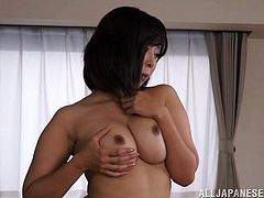 Hot Japanese mom is playing dirty games in the dining room. She strips, sits down on a table and entertains herself by fingering her cunt and kneading her big natural jugs.