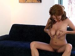 Take a nice look at this redhead cougar, with big tits wearing white panties, while she uses her soft hands to give pleasure to herself.