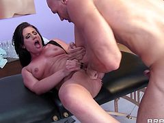 A pretty brunette with long hair, small natural tits and a great ass enjoys a hardcore missionary style fuck on a massage table.