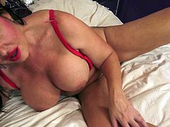 Mature brunette with big tits feels kinda horny. She strips her clothes off and then, starts masturbating. It seems to enjoy herself, while spreading her legs and touching her pussy. She licks her own fingers, to taste her sweet vagina.