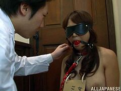 This sexy Asian slave gets blindfolded and is forced to gobble a hard cock just the way she likes it and ends up getting her mouth filled with cum.