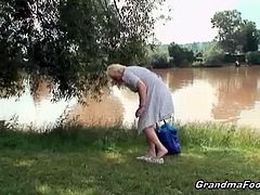 Nasty granny was tanning by the lake and after some beers later she was picked up by two horny and younger dudes. They totally destroyed her old cunt in the woods.