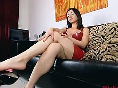 Ella Kross is a sexy mistress who likes to tease her slave. She put on a sexy red latex dress and a pair of heels for this video. She teased with her feet and her heels.