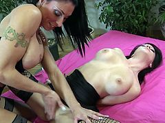 Gorgeous lesbian babes Sassy Meli and Caprice wear some sexy fishnet stockings and lick the hell out of their yummy pussies in the sexiest 69.