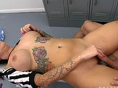 Bosomy tattooed brunette Emily Parker fucks with porn boy Johnny Sins