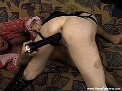 Lewd blonde milf, wearing thong, a bra and high heels, lets a man fuck her twat with a flashlight. After that the dude drills her cunt brutally and uses her face as a cum target.