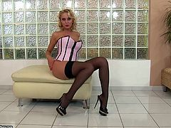 Take a look at this hot solo scene where the naughty blonde teen Mandi Dee fingers her pink shaved pussy while wearing stockings.