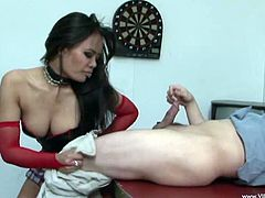 Lewd Latina Annie Cruz is playing dirty games with a guy indoors. She kneels in front of the duden and begins to bite his soft cock.