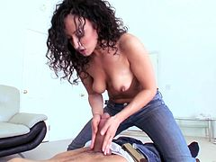 Take a nice look at this brunette MILF, with a nice ass wearing jeans, while she goes hardcore and moans like a wild animal. She's on fire!