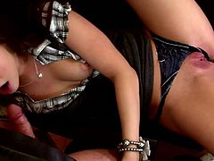 Sextractive dark-haired enchantress wearing black thongs stands on her knees in front of dude and provides him with awesome blowjob. Damn! She does it like an experienced tart!