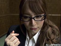 A gorgeous Japanese girl with long hair, petite tits and a fantastic body enjoys a hardcore threesome fuck in her office.