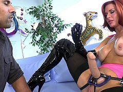 Get a hard dick by watching this redhead femdom, with giant love pillows wearing high heels, while she pegs a black dude's ass passionately.