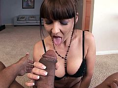 Salacious dark-haired milf Maria Bellucci is gonna empty this dude's BBC. She kneels in front of the stud and works on his huge schlong till it explodes with jizz.