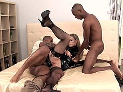 Check this long haired blonde, with a nice ass wearing latex clothes and nylon stockings, while she gets nailed by two big black shafts.