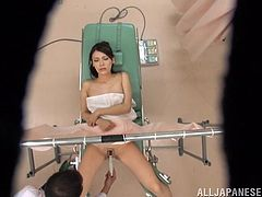 This naughty doctor gets caught by a spy cam while he gives his hot patient a special treat as he toys her yummy pussy during the examination.