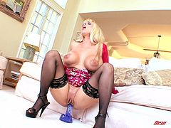 Press play on this hot solo scene and take a look at the sexy blonde mom Holly Halston showing off her huge natural breasts as she masturbates with a large dildo.