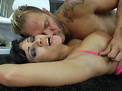 A vivacious cougar with long dark hair, big tits and a shaved pussy enjoys a hardcore doggy style fuck on her living room floor.