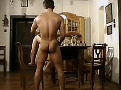 A handsome young gay guy with short dark hair and a fantastic ass enjoys a hardcore doggy style fuck in his dining room.