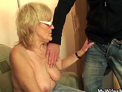 This dude caught his wifey's mom having fun on PornerBros.com and decided to teach her a lesson. He sticked his cock in her mouth and then in her hairy pussy.